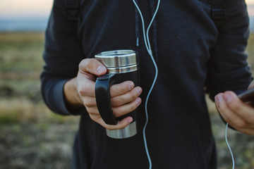 Thermos with warm black coffee.