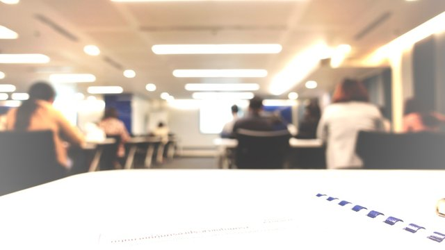 Abstract defocused photo of conference room or seminar room with attendee background, Business concept