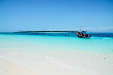 Obraz Boat on the ocean blue sea paradise island view - fototapety do salonu