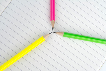 Colored pencils are on the notebook. Macro mode.