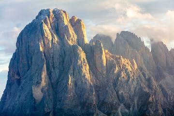 High rock peak in at sunset