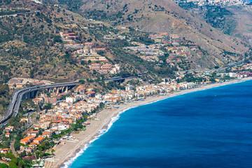 Beach view from Taormina.  Taormina has been main  tourist destination in Sicily since the 19th century. Taormina, Sicily, Italy.