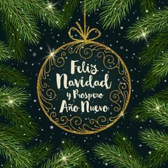 Feliz navidad - Christmas greetings in Spanish. Glitter gold ornate bauble with brush calligraphy Christmas greeting  surrounded by Christmas tree branches.