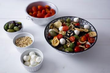 Mediterranean orecchiette with tomato, olives, mozzarella