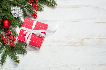 Christmas background with fir tree, present box and decorations