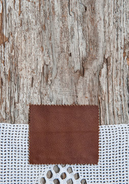 Brown leather and lace on the old wood