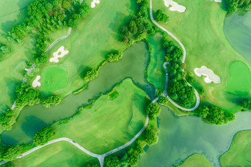 Aerial photograph of forest and golf course with lake