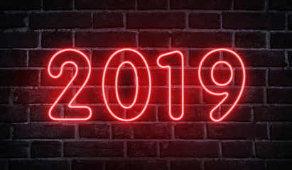 Neon glowing 2019 new year advertising design on wall