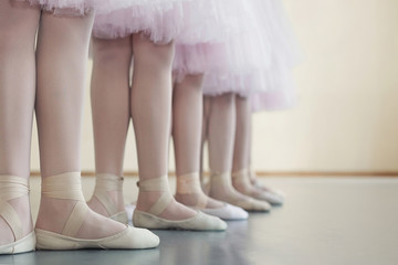 Little dancers legs in pointe shoes, making exercises