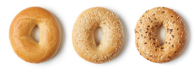 Fresh bagels on white background, from above