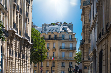 Sun shining over elegant buildings in Paris