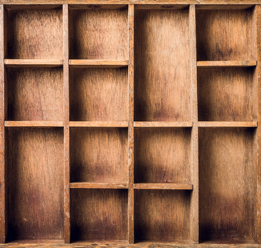 Empty wooden box with compartments, top view.