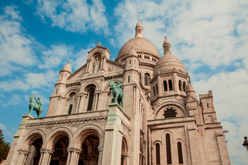 An amazing view of the basilica of Sacre Coeur in a day with a blue sky with clouds. Symbol of the Montmartre district. Paris, France