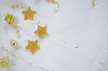 Gold stars are made of wood and painted with gold in color. on the White Blackground.Copy space..