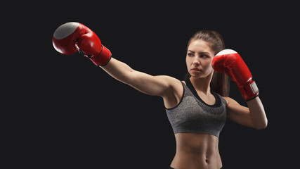 Gorgeous young woman with boxing gloves