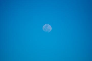 Moon rising at clean sky.