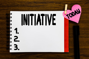 Conceptual hand writing showing Initiative. Business photo text Ability to assess and initiate things independently Motivation Open notebook page markers holding paper heart wooden background