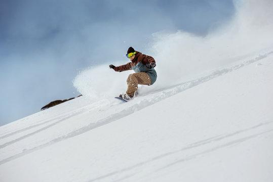 Snowboarder offpiste slope downhill fast