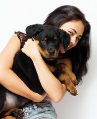 girl hugging puppy