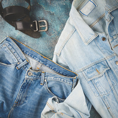 Total denim look. Blue jacket, jeans and black. Flat lay photo fashionable men's clothes