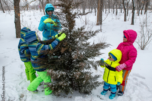 068dc2fd3fab Happy young mother in blue ski suit wearing sunglasses with funny ...