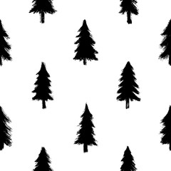 Seamless pattern with black hand-drawn in ink trees isolated on white background. Christmas wallpaper. Doodle style grunge shapes.