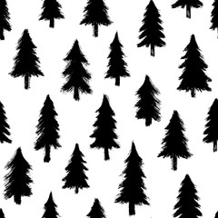 Seamless pattern with hand-drawn pine trees isolated on white background. Christmas forest wallpaper. Doodle style grunge shapes.