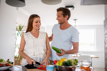 Cheerful couple having breakfast together at home