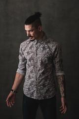 Studio Portrait Of Fashionable Young Man