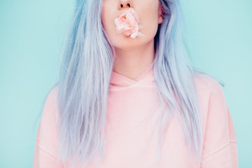 Woman Chewing Pastel Cotton Candy