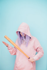 Woman With Long Lilac Hair in Pink Hoodie Holding Baseball Bat
