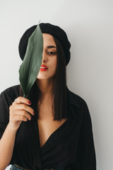Stylish woman with plant leaf