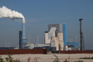 Steam comes out the chimney of the coal power plant of Engie in the Rotterdam Maasvlakte harbor in The Netherlands.