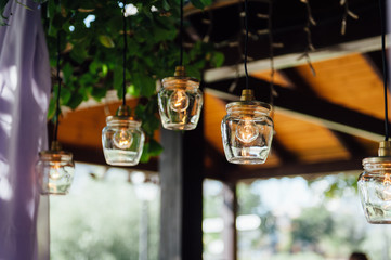 Light bulb decor in outdoor wedding ceremony