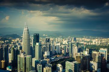 Famous Petronas Twin Towers skyscrapers Kuala Lumpur, Malaysia. Aerial skyline view