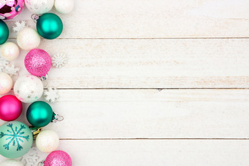 Pastel Christmas bauble side border over a bright white wood background