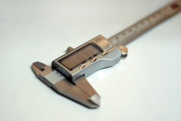 modern digital caliper on a light background, partial blur