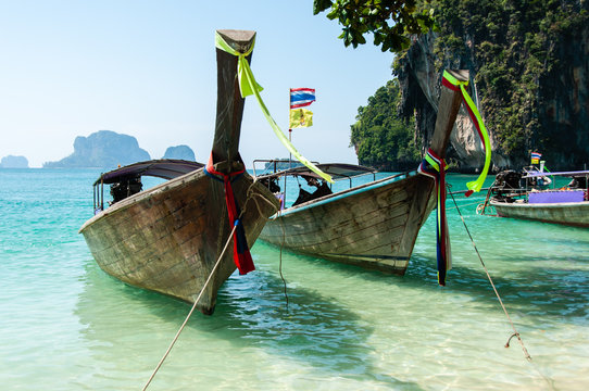 Thai wooden boats on an island of Krabi. Thailand, South East Asia.