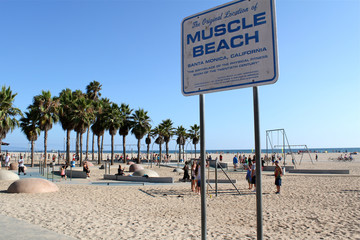 "Los Angeles, USA - July 30, 2017: Sign on the beach declairing ""Muscle Beach"" at Venice beach"