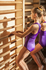 Little girls doing exercise in gym