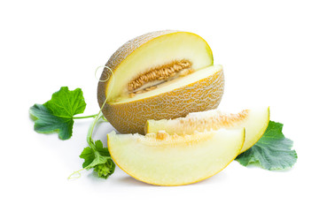 Honeydew sliced melon with sprig isolated on white