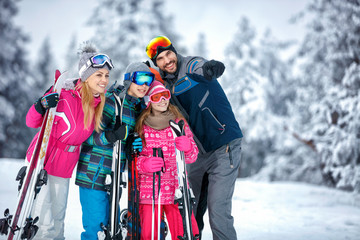 Skiing, winter, snow, sun and fun - family enjoying holiday vacations