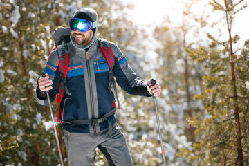Extreme winter sports - Man hiking in the forest