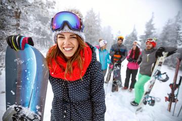 Female snowboarder on ski terrain