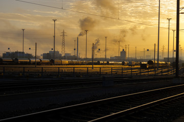 Sunrise glow, railways tracks and carriages at the cargo terminal of Basel, Switzerland.