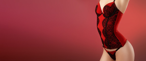 Sexy Woman in Fashion Red Lingerie Corset. Valentine Day Erotic Style. Passion Concept with Copy Space. Perfect Shape