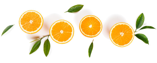 Half cut oranges and green leaves. Wall mural