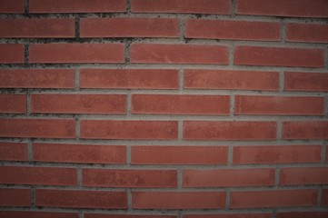 red brick wall with cement