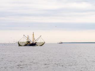 Fishing trawlers at sea, Netherlands