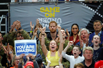 Britain's Prince Harry and Meghan, Duchess of Sussex, watch the Invictus Games Sydney 2018 wheelchair basketball gold medal match at Quaycentre in Sydney, Australia